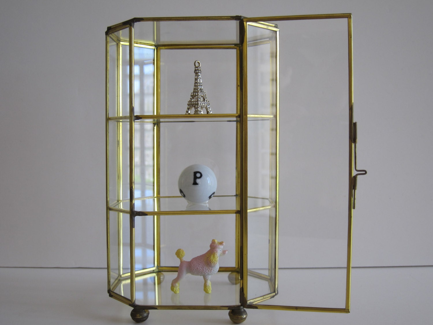 Glass And Brass Curio Cabinet Footed Curio Cabinet Octagon