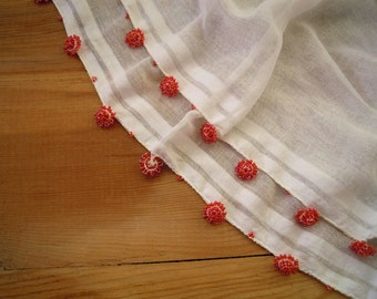 white cotton scarf with beaded edging, orange flower