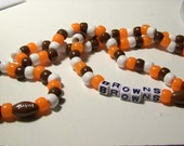 Cleveland Browns Football Team,  Necklace and Bracelet made with pony beads and includes a football bead and block letters
