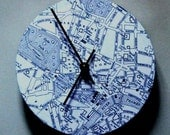 Map clock made of a 1950s map of London.  Black and white.