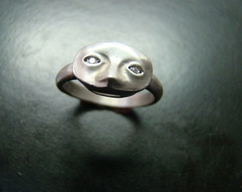 Unique Sterling SIlver Mask ring with genuine diamonds