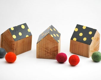 Set of 3 wooden houses. Black roof with gold leaf dots.