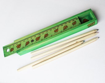 Leaf Green Pencil Box - Green wooden pencil case with ruler and pencils.