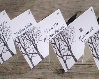 Tree branches with heart handwritten wedding place cards, tented escort cards for your nature inspired wedding