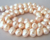 Pale peachy pink freshwater pearls, 8mm x 6mm, full strand, champagne