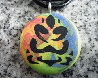 buddha-lotus hand carved on a polymer clay multicolor background. Pendant comes with a FREE necklace