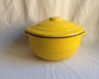 Vintage yellow enamel pot. Casserole lidded pot