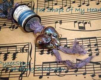 Sutured Heart necklace - Baroque Pearl, recycled spools, sari silk, vintage skeleton key, mother of pearl buttons - The Shape Of My Heart