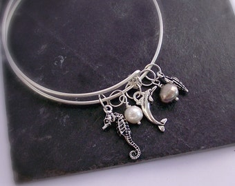2.99 SALE. Silver plate Charm bangle bracelet.  Adjustable charm bangle. Silver  Seahorse Dolphin Conch Pearls Stacking bangle.