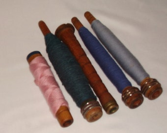 5 vintage wood bobbins - 4 with thread - 1 with original paperwork - 3 of 1 style, other 2 different