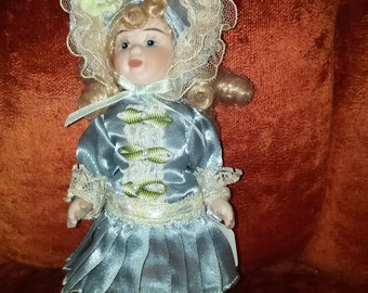 Victorian Goldilocks All Body Porcelain Little Girl Pram Doll in Blue Satin and Lace