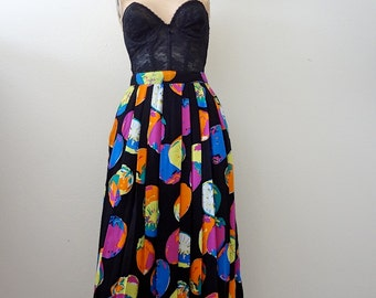 1980s Pleated A-line Skirt / rayon midi skirt with strange fruit print / vintage spring fashion