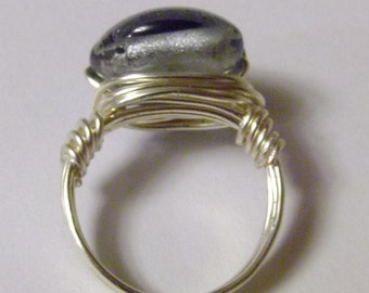 Wire wrapped ring gray glass bead 20 gauge silver tone wire handmade smoky gray bead is half inch in diameter.
