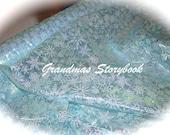 discontinued looks like the DISNEY RESORT BOUTIQUE Frozen Elsa iridesent Auora Bourilis Rainbow blue organza snowflake cape dress fabric