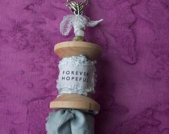Pandora's Wooden Spool Pendant, spool pendanr, decoupage pendant