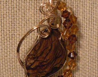 Lovely Biggs jasper, accented with brown and gold glass beads, wrapped in gold filled wire.