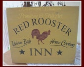 Red Rooster Inn wood sign