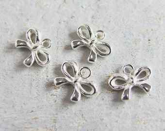 4 of 925 Sterling Silver Tiny Bow Charms 6x8 mm. :th2058