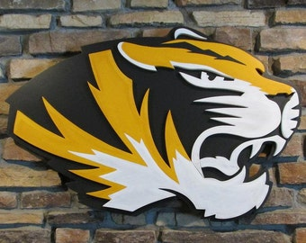 Mizzou Tigers logo hand crafted from wood with a custom paint finish