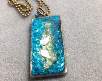 Dimensional peacock inspired glitter resin pendant