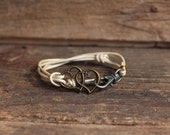 Brass heart and leather wrap bracelet