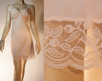 Adorable 1960's vintage glossy silky soft pale peach nylon and matching sheer lace bodice and hem detail mini slip petticoat - 2963