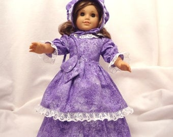 Purple and white print on lavender, long dress for 18 inch dolls, with white lace trim.