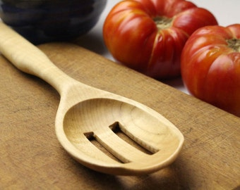 Handmade slotted spoon ,  food preparation , strainer spoon , colander spoon used to serve fruit and vegetables