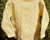 Pale yellow handknit aran cable girls sweater jumper OOAK with shoulder buttons and cute hat with flower.