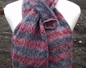 Hand knitted lacy self patterning scarf with pocket. Adult women or teenage girl.