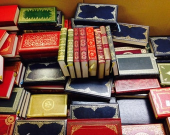 Set of 25 Heron faux leather gilt spine books