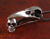 """Raven Skull with Human Skull Necklace - Antique Silver Raven Skull with Tiny Human Skull on 24"""" Gunmetal Chain"""