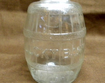 Vintage Lucky Bank glass barrel bank from early 20th century