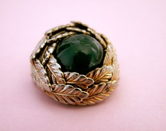 Vintage round brooch with green cabochon, leaves in golden tone 1960s