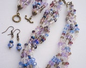 Elegant Crystal Beaded Jewellery Set - Necklace - Bracelet - Earrings in light lilac and blue colours