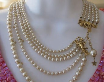 Incredible and Rare Early KIRKS FOLLY Special Occasion Cherub Pearl Necklace and Five inch Cherub Earring set