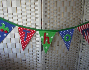 Personalised banner, name bunting. Green, red, blue. Choice of applique motifs. Nursery. Christening. Baby. Fabric. Per flag.