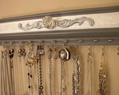 """Jewelry organizer. This gray and white center rack has 11 hooks for necklaces, space for 11 pairs of earrings fits in small space 15""""long"""