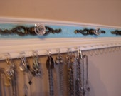 "Jewelry organizer rack 19 hooks for necklaces, space for 19 pairs of earrings at 26""long w/champane embossed background"