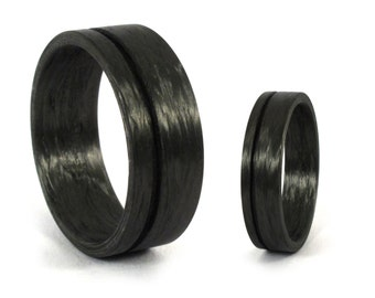 Set of two carbon fiber wedding bands. Unique black wedding rings with one stripe. Water resistant, very durable and hypoallergenic. (00132)