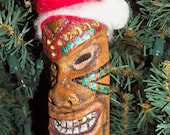 Tiki Ornament with Santa hat