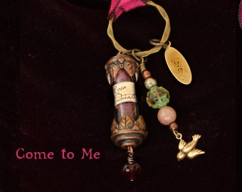 "Talisman, ""Come to Me"",  a witch's charm to attract love."