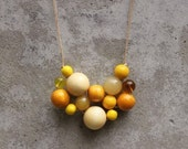 Yellow bib necklace, bead necklace, statement, contemporary, solar power, yellow, woven bead necklace, fashion.