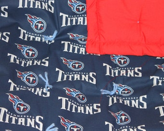Tennessee Titans wrap up in quilt. Show your team spirit while keeping warm.