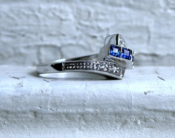 Vintage 18K White Gold Diamond and Sapphire By Pass Ring - 0.44ct.