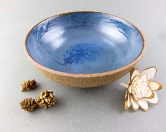 Blue and brown earthen bowl