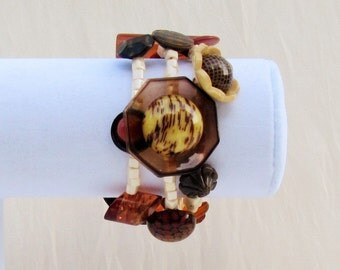 Handmade button bracelet made with Art Deco and 1950's celluloid, bakelite, plastic, and vegetable ivory buttons