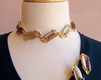 mid century thermoset gold tone linked choker necklace and matching clip earrings of creamy beige and tan brown
