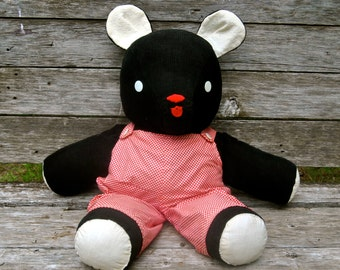1940s black corduroy Teddy Bear with homemade red-checked overalls and button eyes