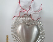 Heart award in silver toned metal with wire ribbon loop